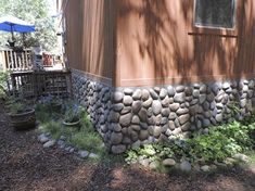 Wall Exterior, Exterior Siding, Faux Rock Panels, Rock Retaining Wall, Backyard Retaining Walls, Wood Ceiling Panels, River Rock Fireplaces, Stone Fireplaces, Modern Wood Fence