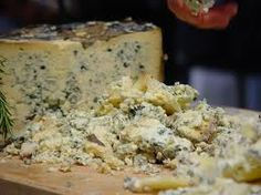"""The Cabrales chese  is a typical chese from Asturias,is a blue-type cheese , this chese hasen""""t got crust and this chese does with  milk."""