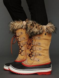 "Joan of Arctic Boot | Suede and leather lace-up boots with rubber bottoms and faux fur trimming. Treaded rubber soles. Waterproof.  *By Sorel  *Leather, Rubber  *Import  *11"" shaft height, 1"" heel"