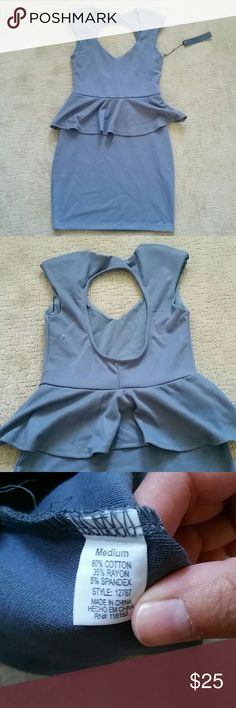 Gray peplum dress Very cute peplum dress with cutout back. Shoulders are padded.  Runs small. poof couture Dresses Mini
