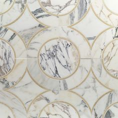 Highland Alpenglow Crema Marfil Calcatta Gold Polished Marble Tile in Gray