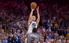 April 2, 2015; Oakland, CA, USA; Golden State Warriors guard Stephen Curry (30) shoots the basketball against Phoenix Suns guard Eric Bledsoe (2) during the fourth quarter at Oracle Arena. The Warriors defeated the Suns 107-106. Mandatory Credit: Kyle Terada-USA TODAY Sports