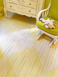:: I like the imperfections in this painted floor (ie: the cracks between the boards) ::  hardwood floor painted yellow