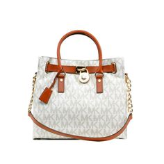Add a distinct style to your wardrobe with the forever fashionable Michael Kors Hamilton Large NS Tote.