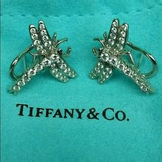 "Tiffany & Co. Platinum Dragonfly Earrings Estate Gorgeous Estate piece and collector's item. Tiffany & Co. Platinum Brilliant Diamond Dragonfly Earrings. Signed/dated 1996.  Brand:  Tiffany & Co. (Special Collection) Year:  1996 Style:  Dragonfly studs, omega back earring Material:  Platinum and diamond Diamond details:  approximately 1.50 ctw round brilliant diamonds Diamond Clarity:  VS Item total weight:  6.7dwt (8.4g) Measurements:  0.83"" length, 0.80 width, 0.15 depth. Earring back…"