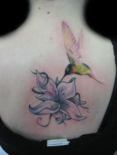 Lily and hummingbird tattoo by Darek Darecki of Poland