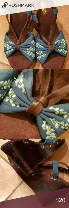 Vintage embroirdered wedges -Seychelles Dark teal with light blue embroirdered flowers. Brown leather with dark brown wood wedged heels. Scratched on sides (see photos)  say size 8, but more like a 7 in length. I love these shoes!  I just can't wear anything so tall. :( Seychelles Shoes Wedges