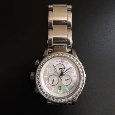 Nixon Chrono Women's Watch In good shape. Only worn a couple of times. Pearl face with diamonds around it. Nixon Accessories Watches