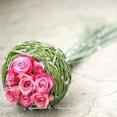 Love the way this ribbon grass shelters he roses, taking ordinary to the extraordinary hot pink roses, bridesmaids bouquets different