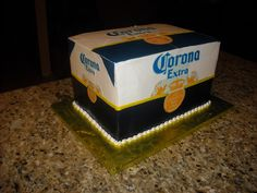 Case of Corona Beer - This is an almost life size cake made to be a case of Corona Beer. It is 4 1/4 sheet cakes stacked with supports. The blue part are wilton sugar sheets and the logo is an edible image. Thanks for looking!