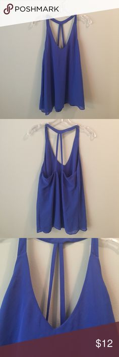 Sexy royal blue dressy tank top Beautiful & flowing blue tank top.  V NECK FRONT - Fun back strap detail.  Pair with jeans or shorts or pants.  Rayon -2 layers  ---- NWOT!   Size L would fit size 6-10 depending on bust. Tops Tank Tops