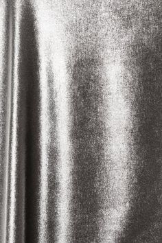 Silver fabric, effects like this can add great depth to a label design @Royston Labels