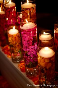Could alternatively do glass vases of submerged orchids as table centrepieces with floating candles? Great for evening wedding