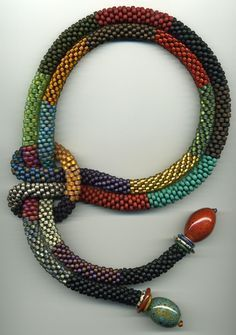 Catherine Hysell.  The knot makes a great element to the necklace that would otherwise be super simple.