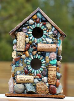 Outdoor Birdhouse and Mosaic Garden Art with colorful stones