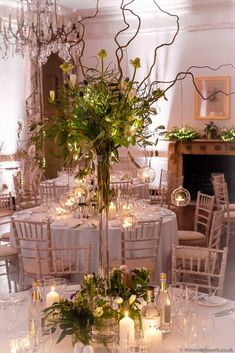 Stunning winter wedding flowers by Bristol florists, The Wilde Bunch at North Cadbury Court. The glowing candles add a warmth to the room on freezing cold winter nights. Country House Wedding Venues, London Bride, Winter Wedding Flowers, Freezing Cold, Beautiful Table Settings, Stage Set, Florists, Winter Night, Stage Design