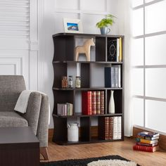 Share your favorite mementos with your guests as soon as they enter the room with the Zeno bookcase. This beautifully structured piece features ample shelving space to display all types of decor, pictures and more.