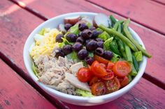 Nicoise (nee-suahz) Salad   tuna, egg, roasted red potatoes, green beans, cherry tomatoes, and Nicoise olives on romaine lettuce, with citrus dressing