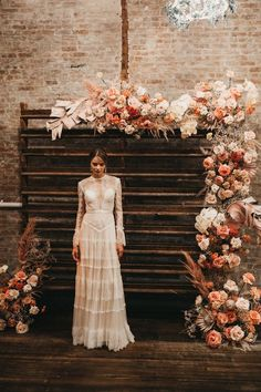 stunning sunset orange and blush floral wood board wedding backdrop ideas