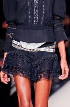 Isabel Marant - very young. I like the pom pom treatment at the edge of the flounces