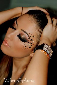 Gorgeous copper toned smokey eye shadow accented with assorted gems and  stunning lashes.