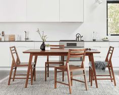 Alwin dining table from Scandinavian Designs. Subtle angles lend visual intrigue to the design, from the table top to the legs. Finished with a teak wood veneer, this airy design looks great in any space and is crafted to last through years of delicious meals.#dining #diningtable #diningroom #teak