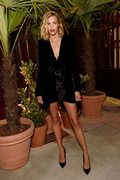 Anja Rubik wore a Saint Laurent by Anthony Vaccarello dress.