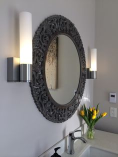 LED wall scones.  Grey bathroom.