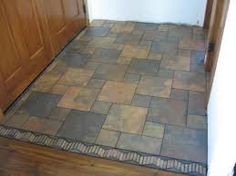 Tile entry way leading to laminate flooring... would save me from ...