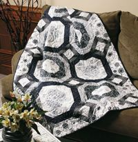 """Shadows Quilt designed by Cyndi Hershey. This block is similar to a traditional Garden Maze setting.It is surprisingly easy to piece using the Diagonal Seams method. Size: 50"""" × 64"""" Blocks: 12 (14"""") blocks.http://www.fonsandporter.com"""