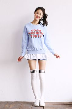 Light blue printed sweatshirt with a white blouse and white thigh high socks with black stripes
