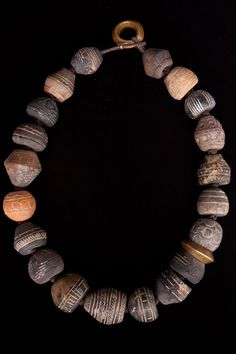 OLD, Mali, clay, spindle whorl beads (31mm X 27mm) with two Ethiopian brass ring beads, 23 inches long necklace.