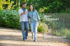 Stock Photo : Happy mature couple walking in a garden