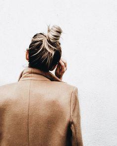 beige coat / messy hair