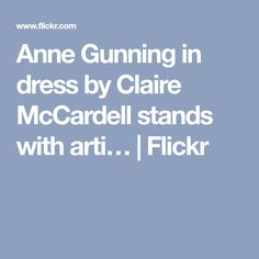 Anne Gunning in dress by Claire McCardell stands with arti… | Flickr