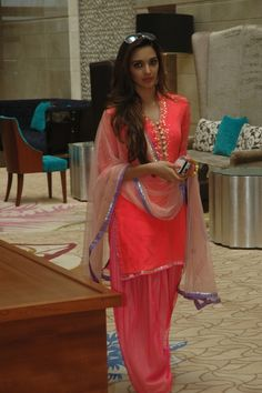bollywood actress kirara advani in beautiful peach color quarter sleeves salwar kameez designed by kanika kedia .paired with patiala salwar.