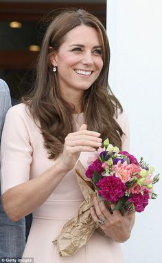 Kate was presented with numerous bunches of flowers by well wishers
