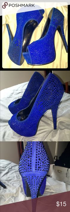 BLUE AND BLACK STUDDED PLATFORM PUMPS These blue platforms have blue and black gems on them. The heel is 4 inches, the platform is about an inch. A few gems missing around the heel of the left shoe but u can barely notice. Shoes Platforms