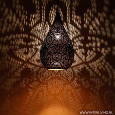 Warm light & schadows from this pendant drop model of filigrain.