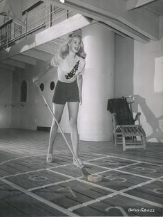 Barbara Bates playing shuffleboard