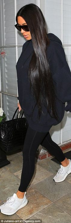 All black: The wife of Kanye West kept it simple to the doctor's office as she dressed in tight and shapely leggings, paired with an oversize hooded sweatshirt