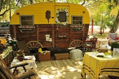 vintage camper trailer - love the painted-on wagon wheels - very clever.