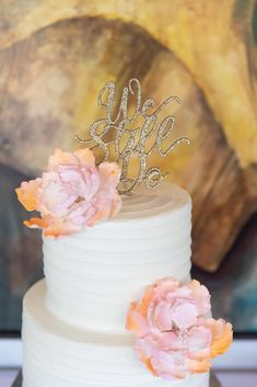 Buttercream Disney Fairy Tale Wedding Cake with pink floral and glitter cake topper