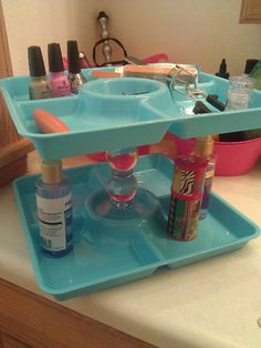 finally made my own. two trays from dollar tree and a candle stick holder for a $4 beauty organizer!