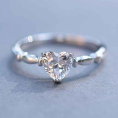 Sterling Silver Simple CZ Heart Promise Ring ($30) ❤ liked on Polyvore featuring jewelry, rings, heart jewellery, cz rings, handcrafted rings, heart shaped cubic zirconia rings and cz heart ring