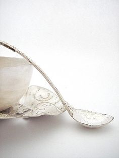 Brilliant silversmith Miranda Meilleur. Silver bowls, silver spoon and silver saucer