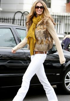 Steal The Look / Steal Elle Macpherson's look by combining a trendy fur vest with white pants.