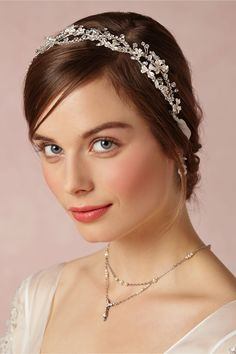 """Iva Halo BHLDN: Capture the essence of ethereal beauty in this embellished halo of silver florets and Swarovski crystals. This Justin & Taylor original is right at home in a classic or vintage-inspired wedding, or as a touch of """"something old"""" to a more modern look. #vintage #romantic #bride"""