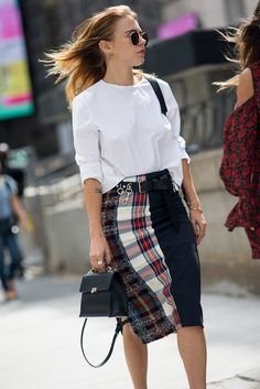 Street style from SS17 New York Fashion Week. Your style takeout? Clash your patterns – plaid meets tartan on this pencil skirt – for fashion points this autumn. Also, multiple earrings are never not hot
