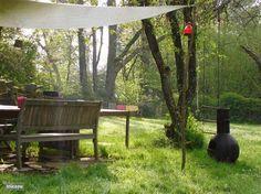 Geen strak gazonnetje maar een heerlijke tuin om in te relaxen of te ravotten